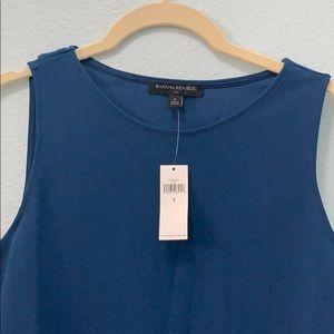 Beautiful cross back sleeveless blouse!